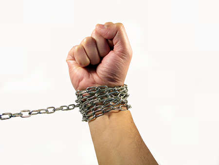 chained hand, the concept of being tied to something and slavery photo