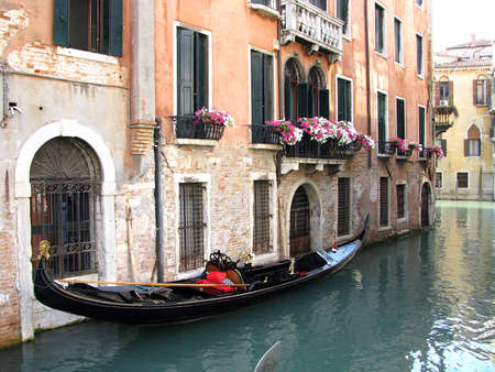 Canal in venice and Gondola Stock Photo - 16816833