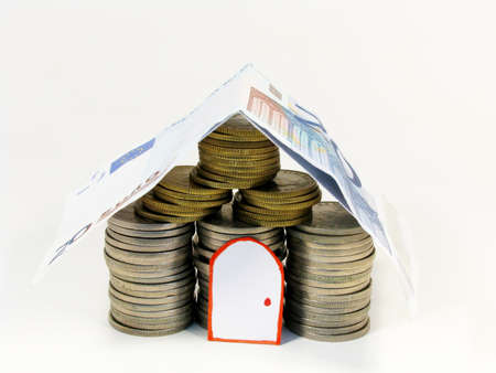 Stacks of coins shaped house Stock Photo - 16917503