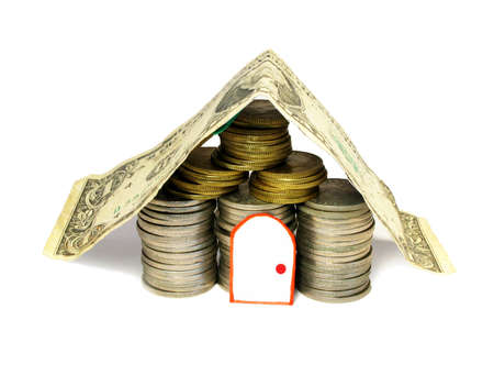 Stacks of coins shaped house photo