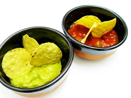 mexican nachos and salsa dip yellow and red Stock Photo
