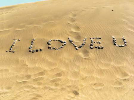 written in the sand withstone photo