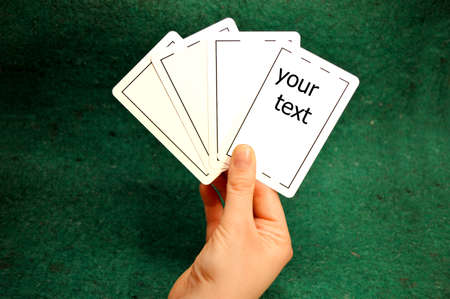Hand holding Poker cards Royah flush isolated against white and space for your text
