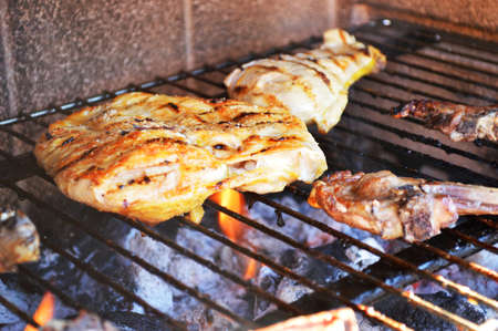 chicken, pork ribs grilled on a barbecue photo