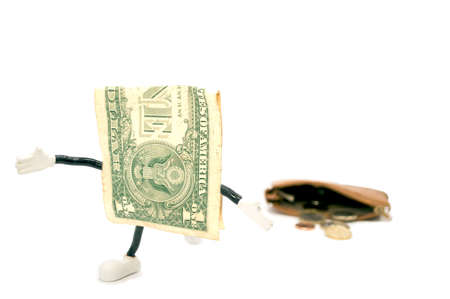 one dollar  escaping from a purse Stock Photo - 17343986