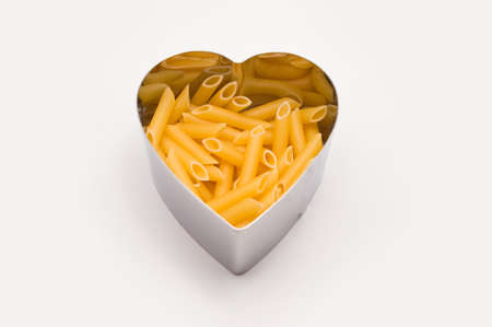 heart shaped mold filling penne rigate photo