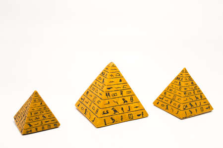 pyramids  with hieroglyphs on a white background