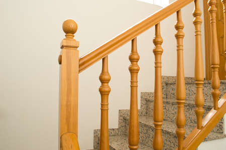 wooden railing  installed in a Staircase