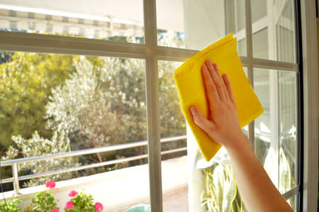 yellow house: Women cleaning a window 2