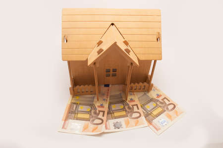 house on top of money by way of mortgage Stock Photo - 17560254