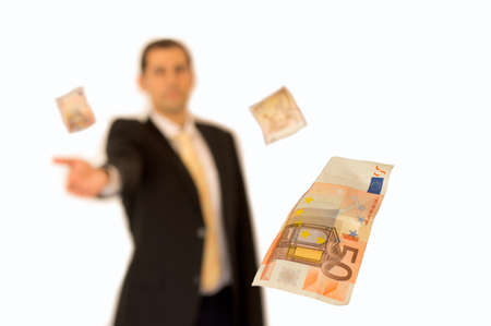 Business man handing a money with background white photo