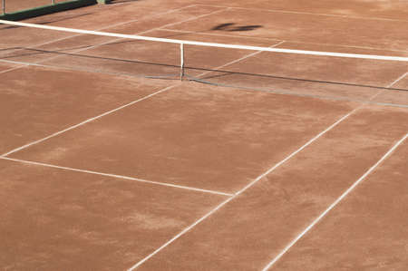 Clay surface tennis court  Dirt surface tennis court photo