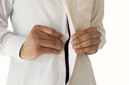 buttoning: Detail view of  businessman adjusting her shirt buttons