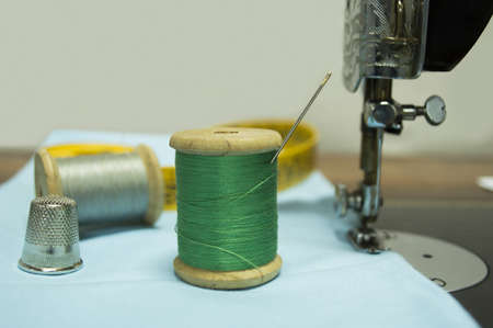 green wire with a thimble and needle Stock Photo - 18244982