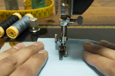 hand sewing on an old sewing machine Stock Photo - 18245022