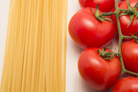spaghetti and tomatoes on a table ready to cook Stock Photo - 18285205