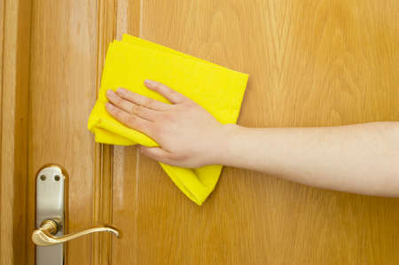 cleaning wooden door photo