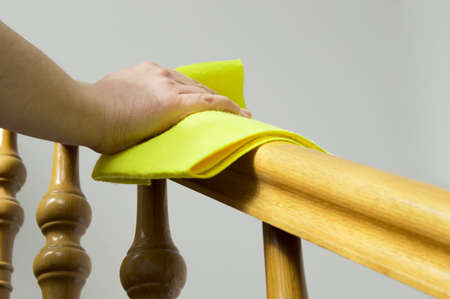 cleaning wooden railing  photo