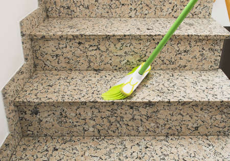brush cleaning the stairs marble Stock Photo
