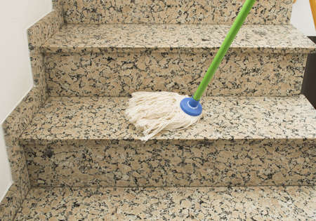 mop cleaning the stairs marble