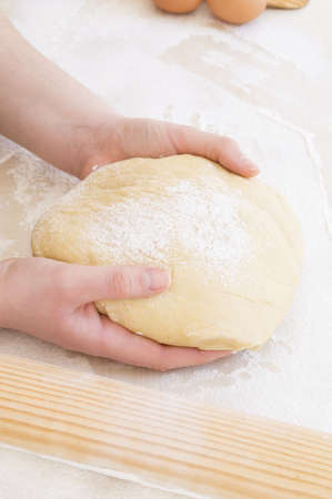 taking the dough with both hands Reklamní fotografie - 18930082
