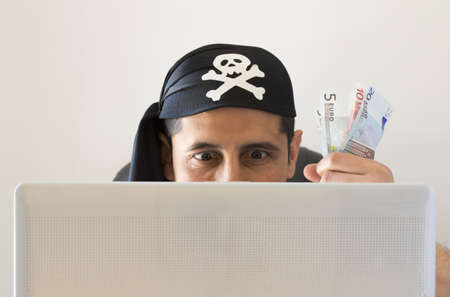 hacker watching and stealing virtual money in euros on white background photo