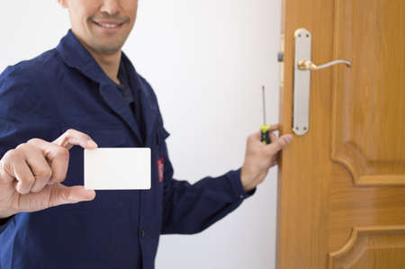 Carpenter shows your card with your number Stock Photo - 18939816