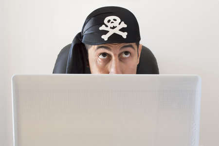 wrongdoing: hacker thinking your next wrongdoing Stock Photo