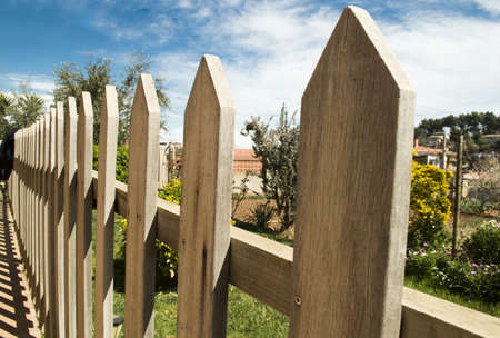 delimit: wooden fence and blue sky background