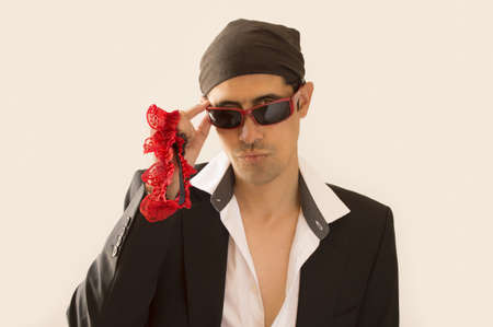 parody of a Latin lover with a garter red  in hand Stock Photo - 19408380
