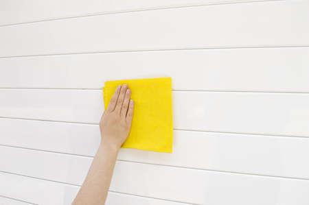 woman cleaning white metal garage door photo