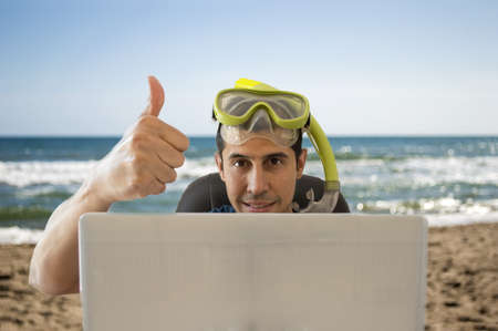 men showing a thumbs up when achieved a great deal for your holiday on the beach Stock Photo