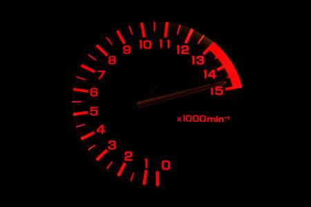 automobile tachometer on black background even faster