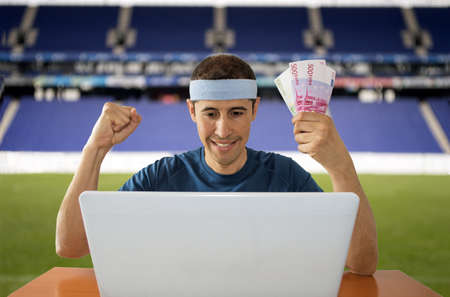 online betting man and making a lot of euros in stadium