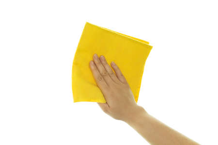 hand holding a yellow cleaning cloth on white background