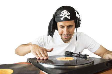 DJ mixing vinyl record on a  turntable with a pirate costume in  white background Stock Photo - 20997544