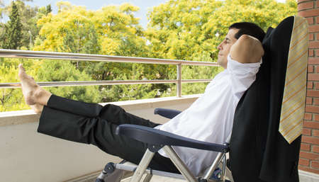 Businessman takes a break on the terrace of the office Stock Photo - 21267399
