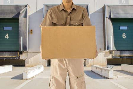 Man offering his goods transportation service from loading bay for trucks Stock Photo - 21267422