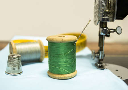 green wire with a thimble and needle Stock Photo - 21578857
