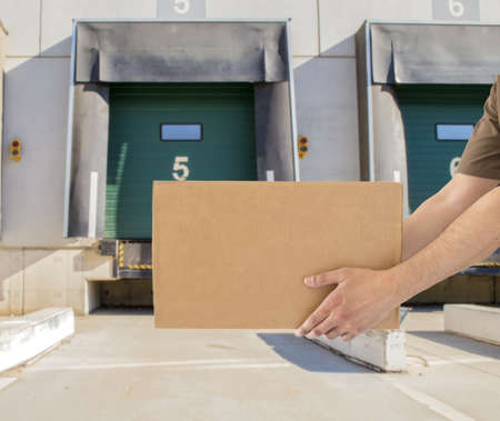 Man offering his goods transportation service from loading bay for trucks  photo