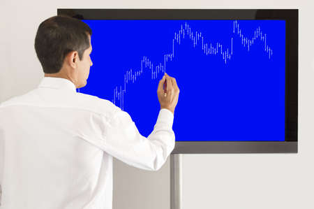 businessman presenting the graph of the market gains photo