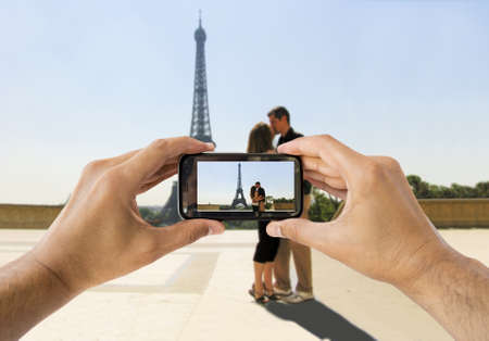 Tourists take a picture with your mobile phone to a newly married couple Stock Photo