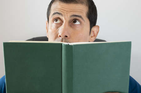 told: man reading a book and imagining the story told