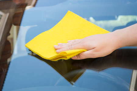 Man cleaning car glass front photo