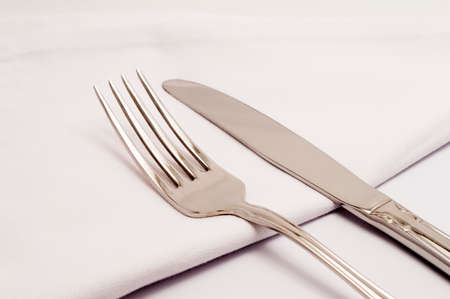 Closeup of a table with a knife and fork photo