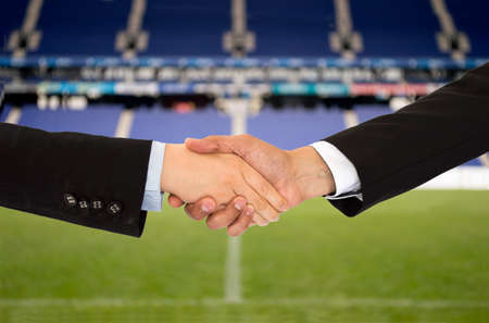 handshake in a business in the sport of soccer