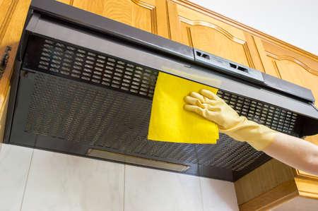 Limpieza capucha de tela de color amarillo Foto de archivo - 23572169