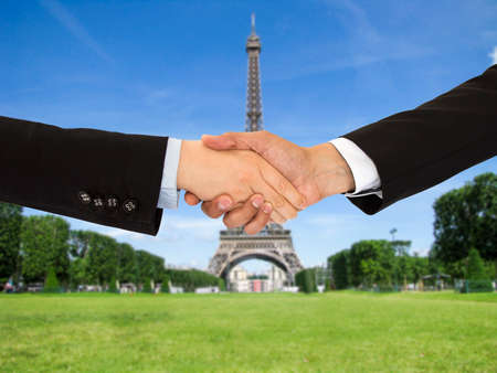 closing a deal with a handshake on a trip to Paris