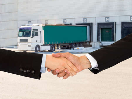 closing a deal with a handshake on transport and logistics business