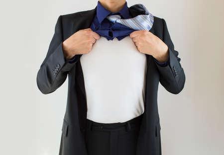 business man imitating a superhero with white background Stock Photo - 24364985